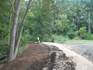 Chips and soil erosion blanket placed on Pond Circle Trail and Berm – seeding with oats and perhaps annual rye will be next